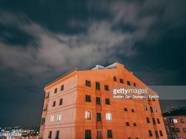 low angle view of buildings against sky at night - middle east stock pictures, royalty-free photos & images