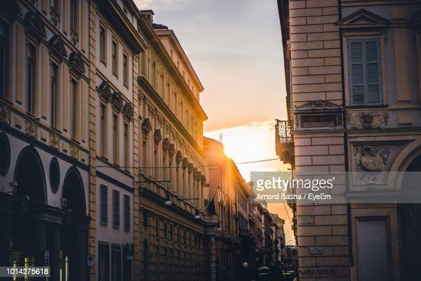 low angle view of buildings against sky during sunset - turin photos et images de collection