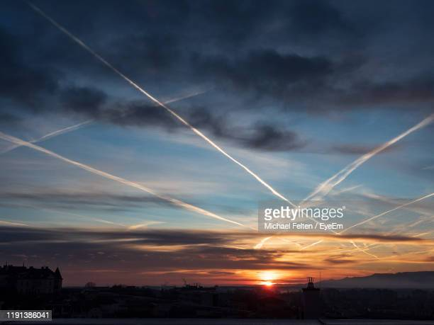 low angle view of buildings against sky during sunset - sankt poelten stock pictures, royalty-free photos & images