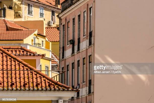 low angle view of buildings against sky during sunset - alfred jansen imagens e fotografias de stock