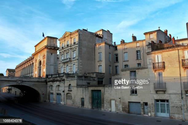 low angle view of buildings against sky in city - montpellier stock pictures, royalty-free photos & images