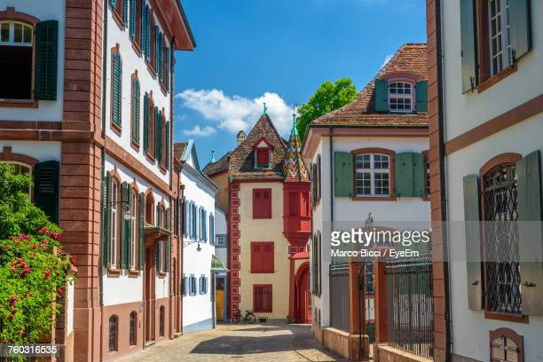low angle view of buildings against sky in city - basel switzerland stock pictures, royalty-free photos & images