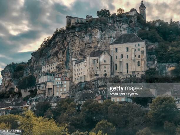 low angle view of buildings against sky - rocamadour stock pictures, royalty-free photos & images