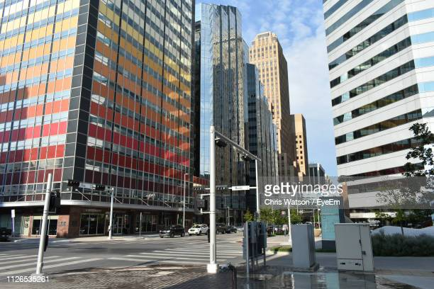 low angle view of buildings against sky - oklahoma city stock pictures, royalty-free photos & images