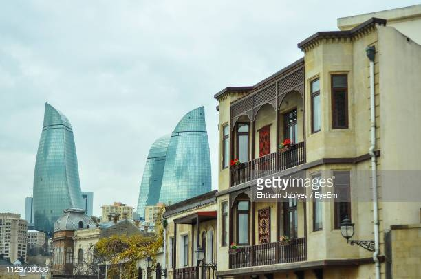 low angle view of buildings against sky - baku stock pictures, royalty-free photos & images