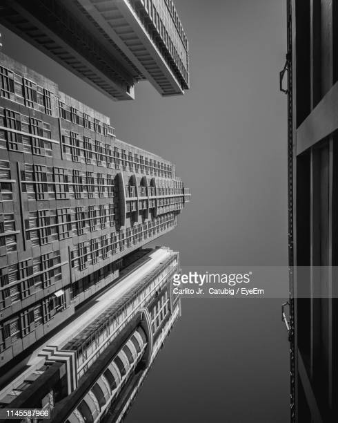low angle view of buildings against sky - makati stock photos and pictures