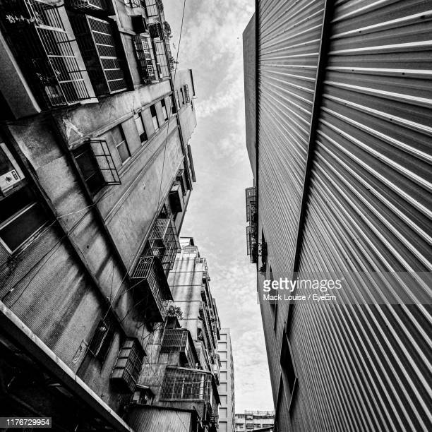 low angle view of buildings against sky - mack stock pictures, royalty-free photos & images