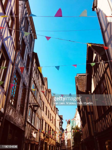 low angle view of buildings against sky - rouen stock pictures, royalty-free photos & images