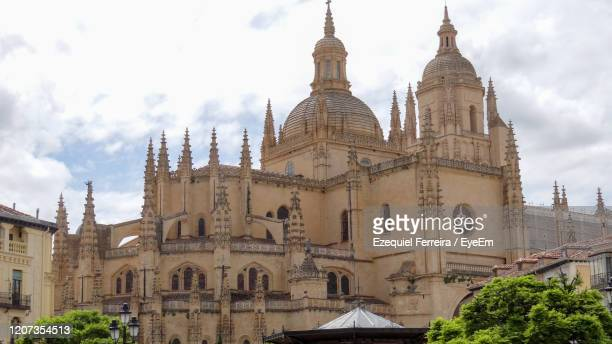 low angle view of buildings against sky - segovia stock pictures, royalty-free photos & images