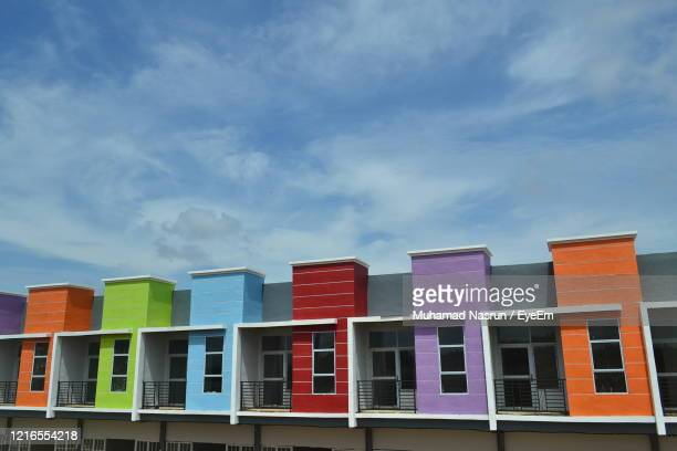 low angle view of buildings against sky - muhamad nasrun stock pictures, royalty-free photos & images