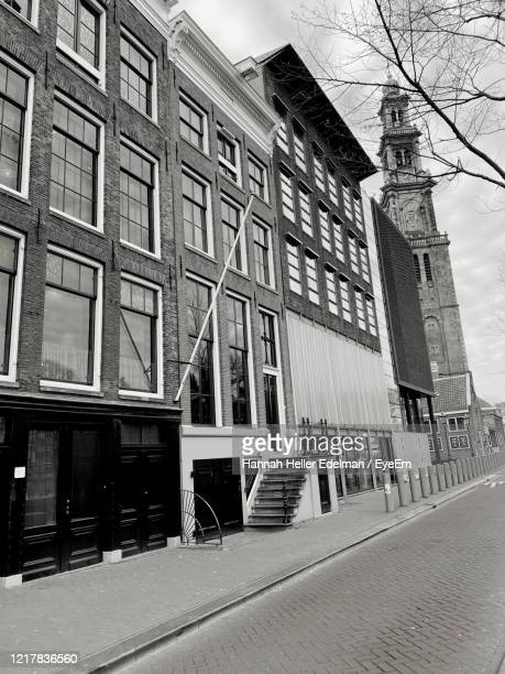 low angle view of buildings against sky - anne frank house stock pictures, royalty-free photos & images