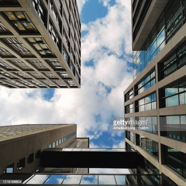 low angle view of buildings against sky - waterloo railway station london stock pictures, royalty-free photos & images