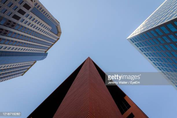 low angle view of buildings against sky - eyeem jeremy walter stock pictures, royalty-free photos & images
