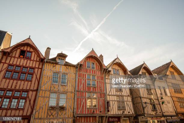 low angle view of buildings against sky - troyes champagne ardenne photos et images de collection