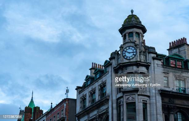 low angle view of buildings against sky - republic of ireland stock pictures, royalty-free photos & images