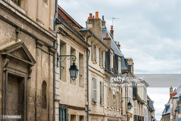 low angle view of buildings against sky - cher stock pictures, royalty-free photos & images