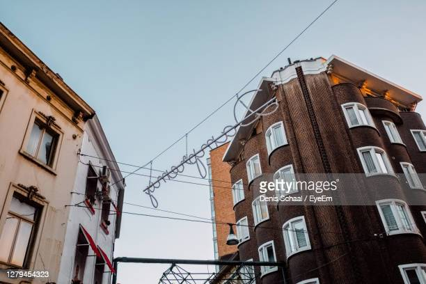 low angle view of buildings against sky - charleroi stock pictures, royalty-free photos & images