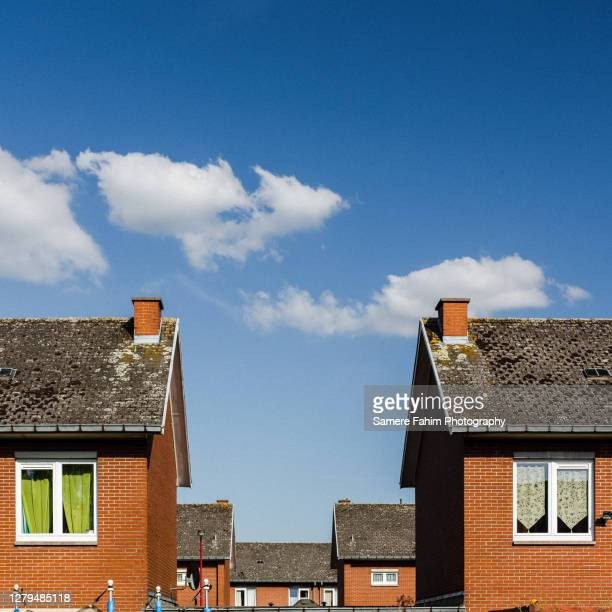 low angle view of buildings against sky - belgium stock pictures, royalty-free photos & images