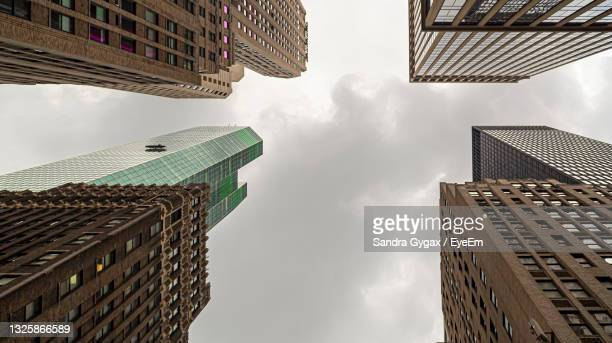low angle view of buildings against sky - sandra gygax stock-fotos und bilder