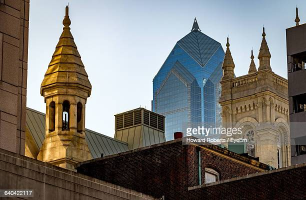 low angle view of buildings against sky - philadelphia pennsylvania stock pictures, royalty-free photos & images
