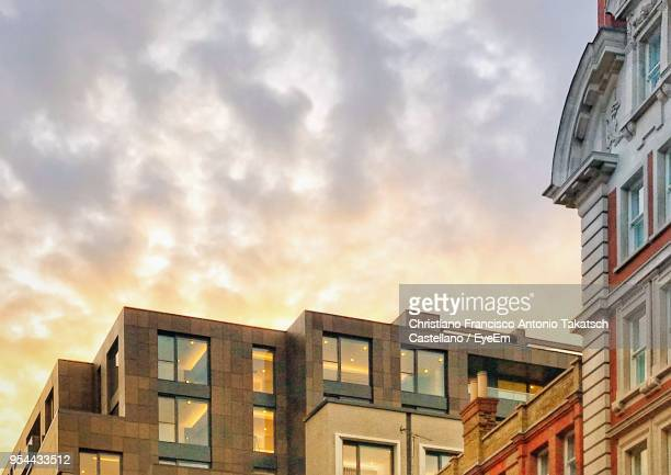 low angle view of buildings against sky - 上部分 ストックフォトと画像