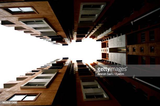 low angle view of buildings against sky - bangalore city stock pictures, royalty-free photos & images