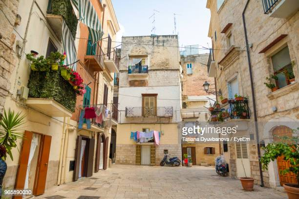 low angle view of buildings against sky - bari stock photos and pictures