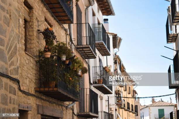 low angle view of buildings against sky - castellon province stock pictures, royalty-free photos & images