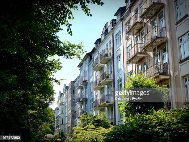 low angle view of buildings against sky - hamburg germany stock pictures, royalty-free photos & images