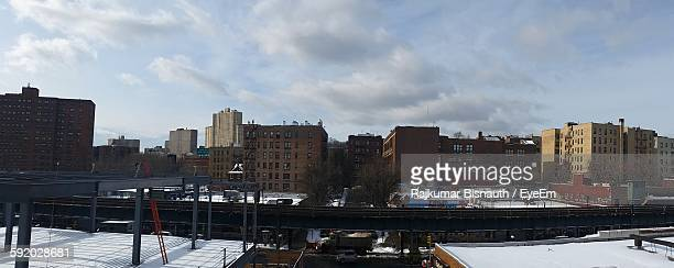low angle view of buildings against the sky - the bronx stock pictures, royalty-free photos & images