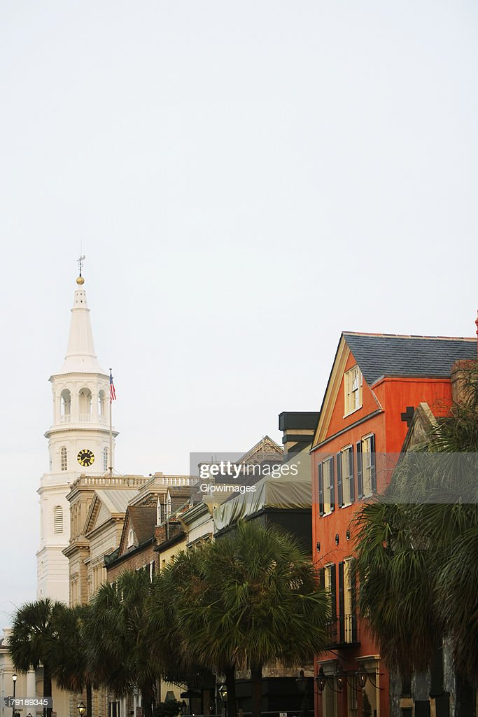 Low angle view of buildings and a church, St. John's Lutheran Church, Charleston, South Carolina, USA : Foto de stock