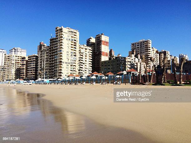 Low Angle View Of Buildings And Beach Against Clear Sky