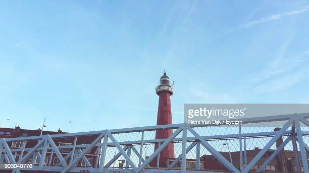 Low Angle View Of Buildings And Lighthouse Against Sky