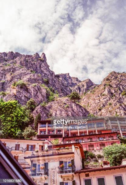 low angle view of buildings and mountains against sky - rachel wolfe stock pictures, royalty-free photos & images
