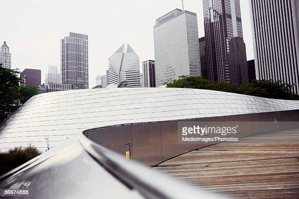low angle view of buildings in a city, aon center, two prudential plaza, chicago, illinois, usa - millenium park stock photos and pictures