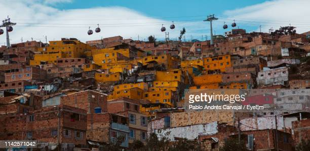 low angle view of buildings in city - carvajal stock photos and pictures