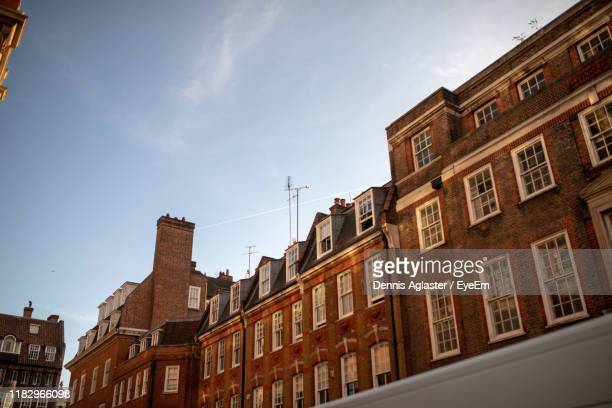 low angle view of buildings in city - central london stock pictures, royalty-free photos & images