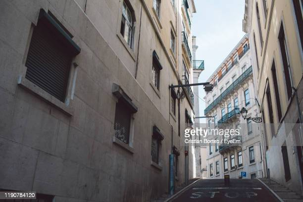 low angle view of buildings in city - bortes stock photos and pictures