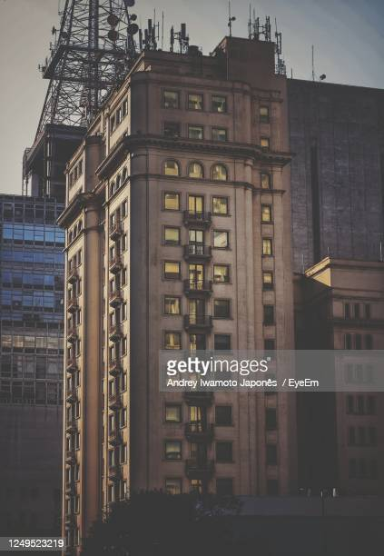 low angle view of buildings in city - japonês stock pictures, royalty-free photos & images