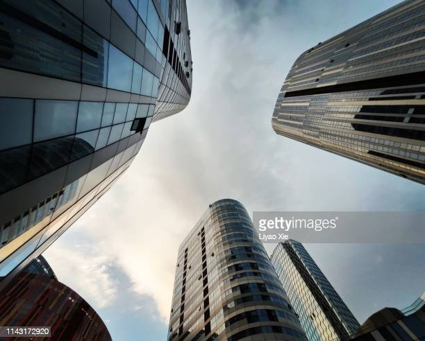 low angle view of buildings in sanlitun - liyao xie stock-fotos und bilder