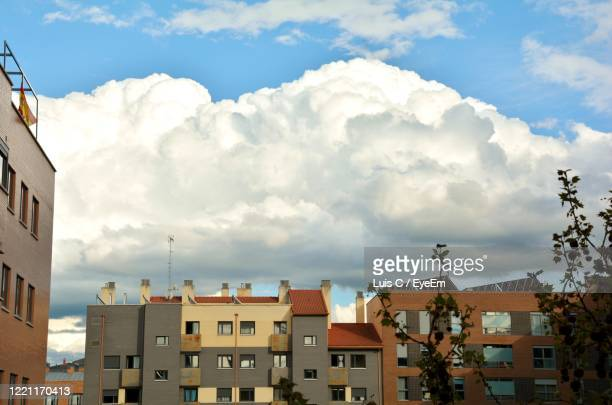 low angle view of buildings in town against sky - valladolid spanish city stock pictures, royalty-free photos & images