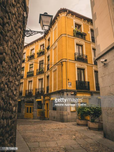 low angle view of buildings in town - madrid stock pictures, royalty-free photos & images
