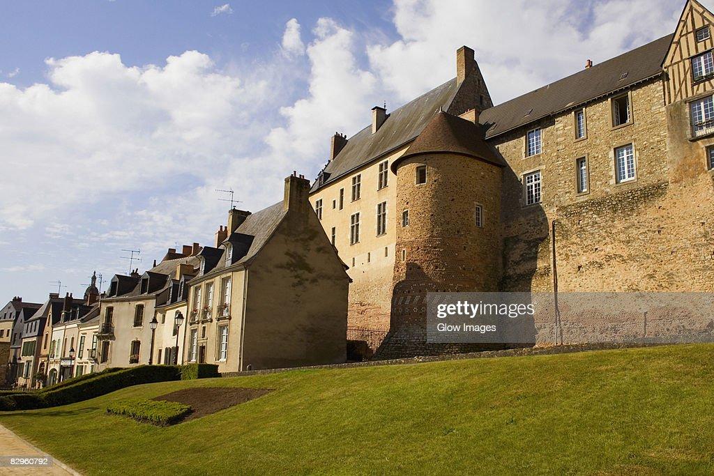 Low angle view of buildings, La Tour de Tuce, Le Mans, France : Stock Photo