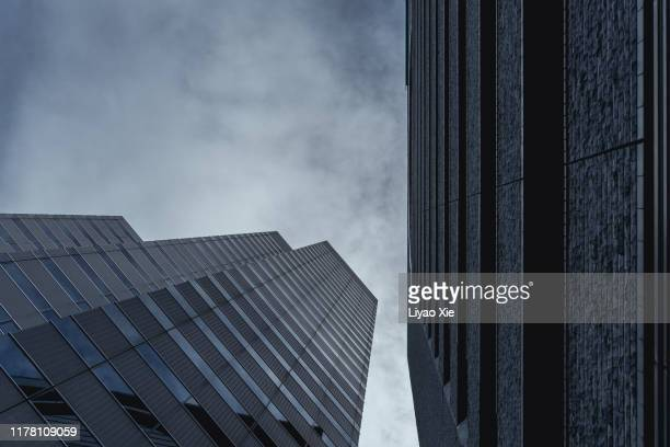 low angle view of buildings - liyao xie stock-fotos und bilder