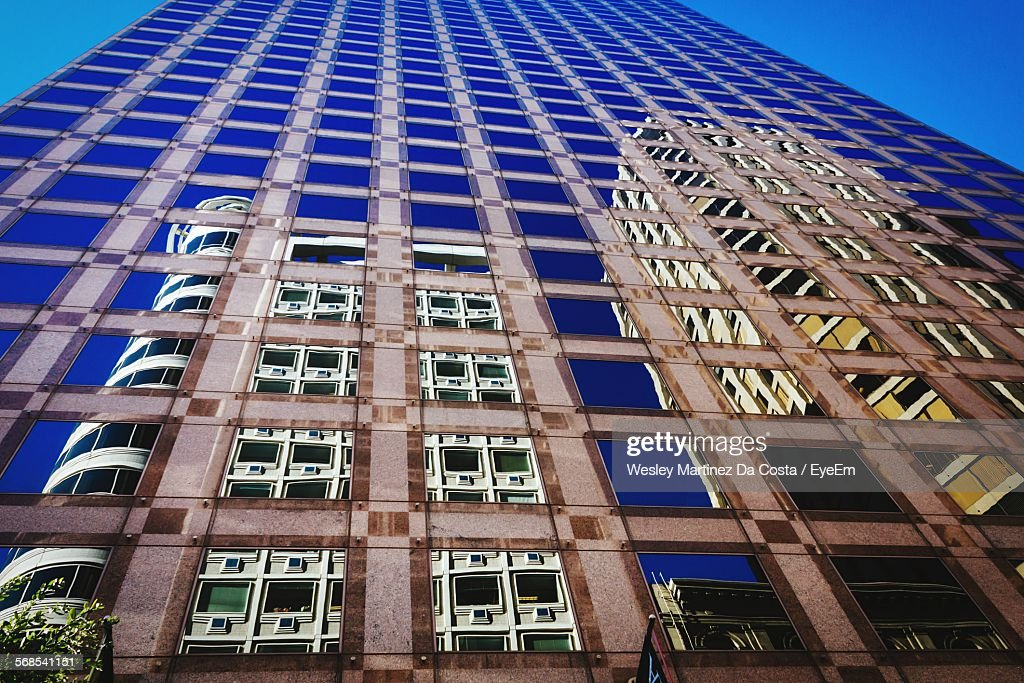 Low Angle View Of Buildings Reflection On Skyscraper : Stock Photo