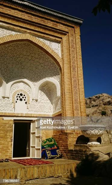 low angle view of built structure against blue sky - osh stock pictures, royalty-free photos & images
