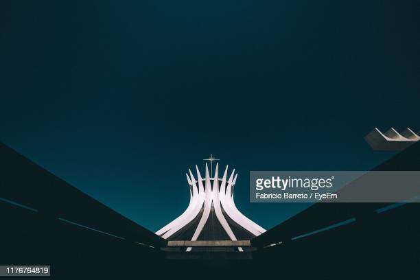 low angle view of built structure against clear sky at night - distrito federal brasilia stock pictures, royalty-free photos & images