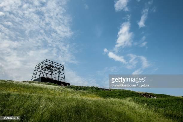 Low Angle View Of Built Structure On Field Against Sky