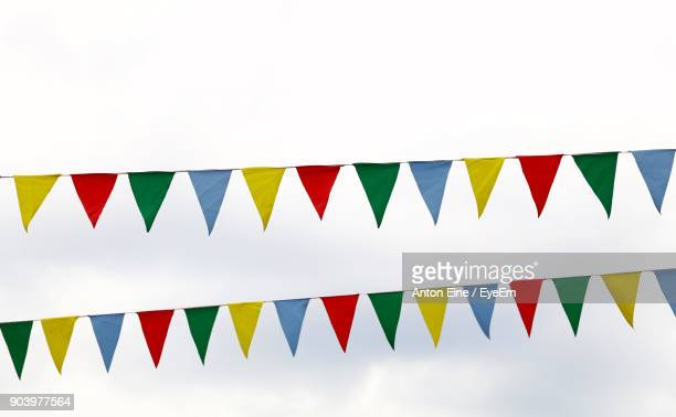 low angle view of bunting against sky - bunting stock pictures, royalty-free photos & images