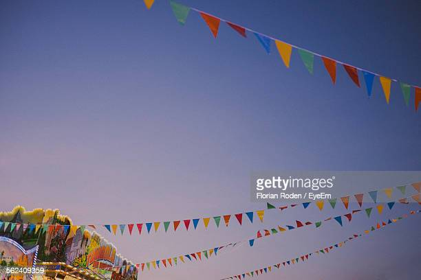 Low Angle View Of Buntings Against Blue Sky